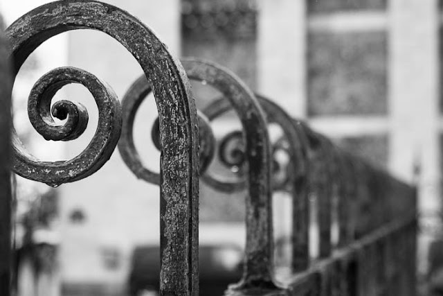 fence posts in the rain at Sacre Coeur
