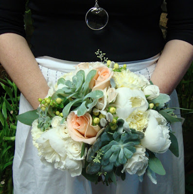 Bridal bouquet of succulents, roses and peonies by Stein Your Florist Co.