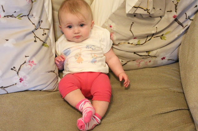 baby girl wearing deep pink leggings and white t-shirt with three mouse holding balloons