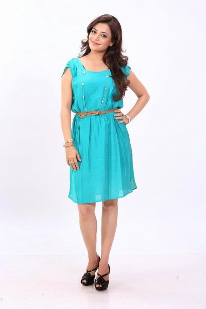 Nisha Aggarwal in Blue Mini Skirt