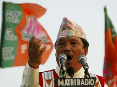 Gorkha Janmukti Morcha president Bimal Gurung with BJP flag