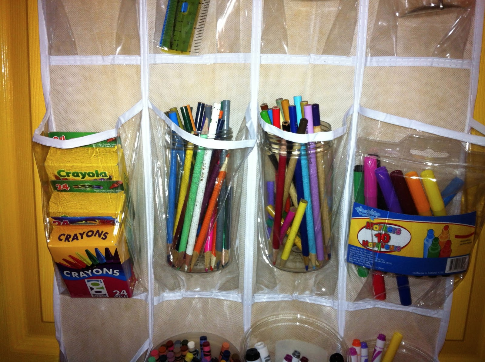 As I started filling each section and figuring out what would make sense for where to place items (for instance Sharpies Up top. & Storing School Supplies in Over-the-Door Shoe Organizers - Blog