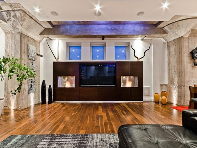 Built in tv in the living room with three small windows above