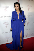 Kim Kardashian wearing a blue floor length dress