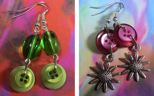 Long drop dangle earrings made with colorful buttons, beads and silver charms