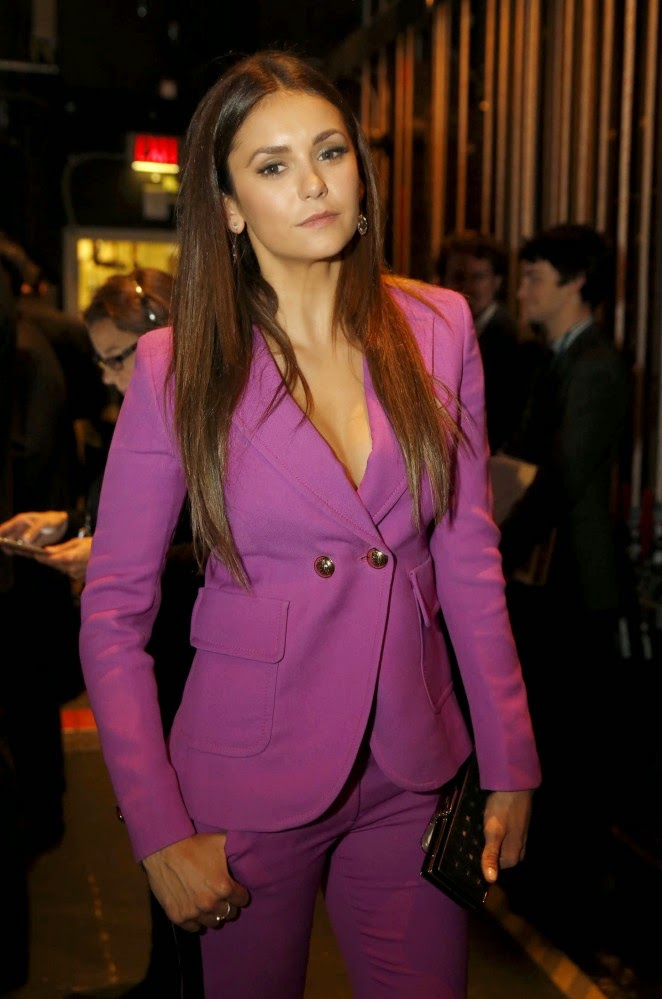 Nina Dobrev flaunts a pink low-cut pant suit at the 2015 NFL Honors in Phoenix