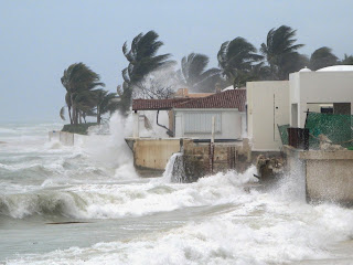 Photo of a hurricane lashing houses on the coast in Puerto Rico.