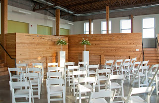 River Market Event Place Kansas City Wedding Flowers hydrangea wood slices modern natura