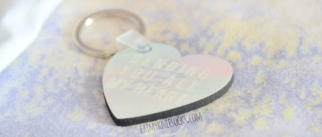 "More photos of my custom-printed heart-shaped pastel print Chinese ""love"" character keychain from Snapmade."