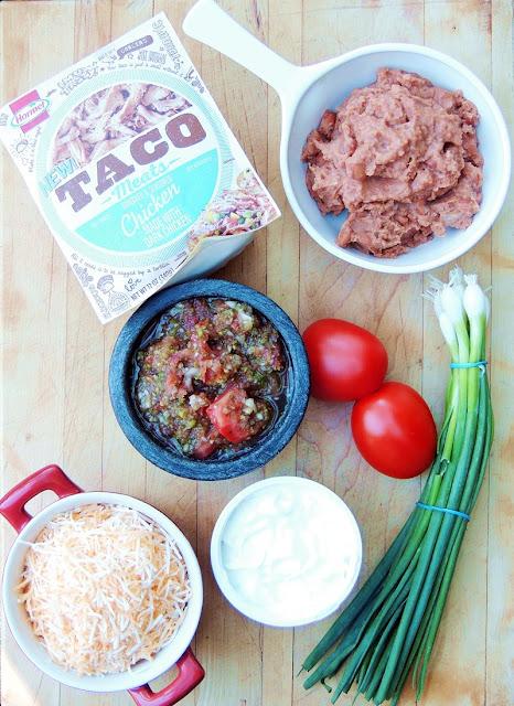 Quick and Easy Shredded Chicken Nachos from www.bobbiskozykitchen.com