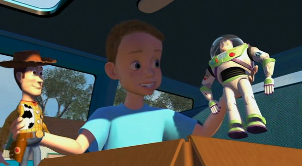 Andy holding Buzz and Woody Toy Story 1995 animatedfilmreviews.blogspot.com