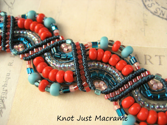 Bracelet knotted in teal, turqoise, marina blue and coral waves pattern