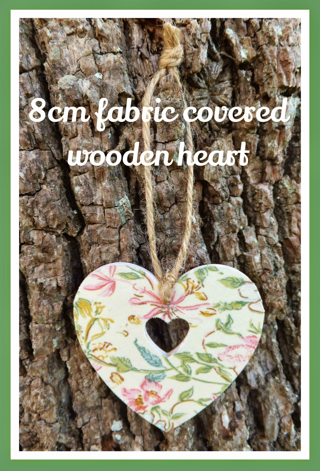 fabric covered wooden heart hanging on tree
