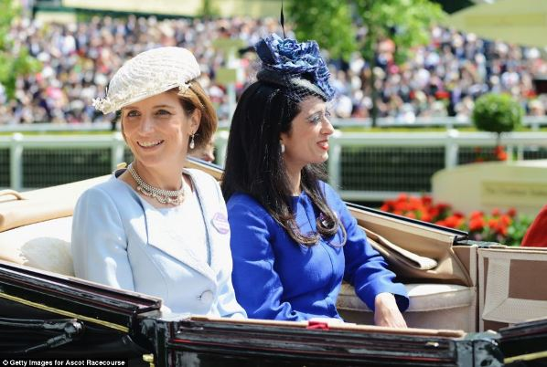 Lady Carolyn Warren (left) and Princess Badiya in contrasting shades of blue on day five of Royal Ascot 2014