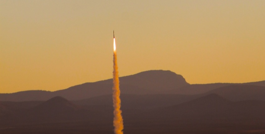 Against a dramatic orange sky at sunrise, UP Aerospace' Spaceloft-9 sounding rocket lifts off from Spaceport America in New Mexico Oct. 23 carrying four experimental space technology payloads. Image Credit: Todd Dickson / Las Cruces Bulletin
