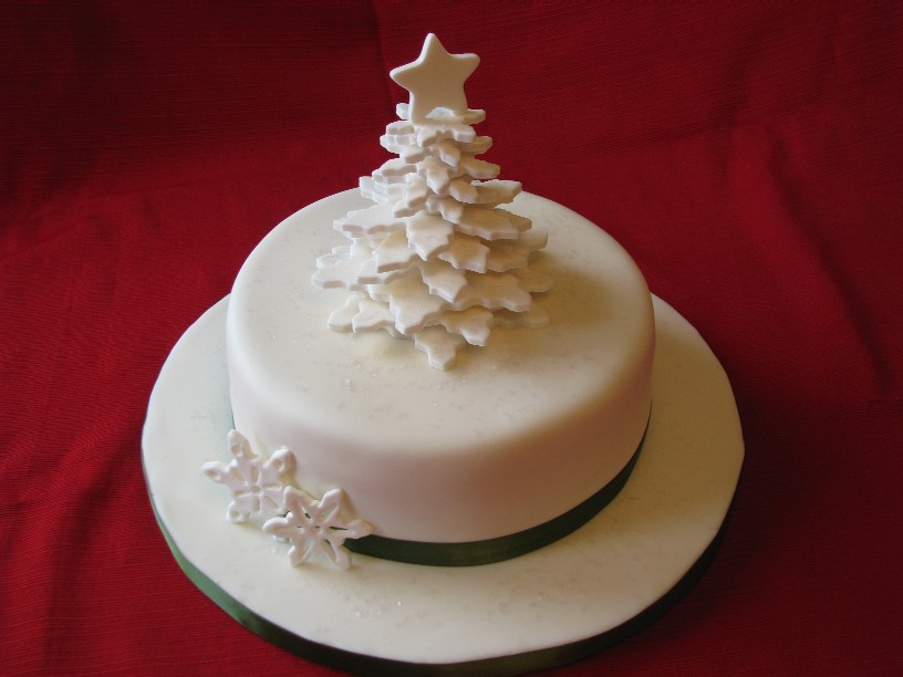 white christmas cake decorated with x mas tree and snowflakes picturetree