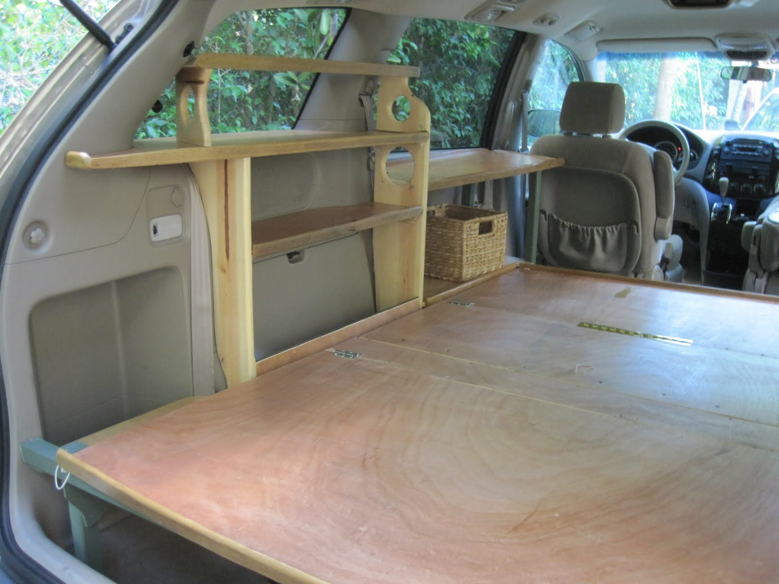 Next, I covered the frame with plywood on hinges. There are four parts