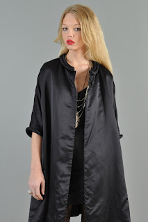 Vintage 1950's trapeze shape black silk opera coat with cropped sleeves.