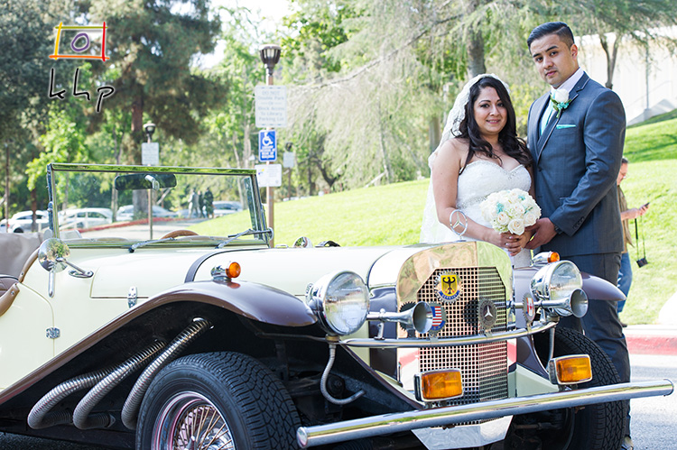 The newly married couple by the vintage convertible Mercedes-Benz