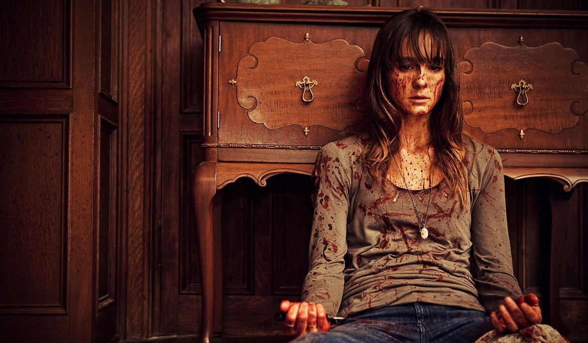 Sharni Vinson covered in blood in You're Next