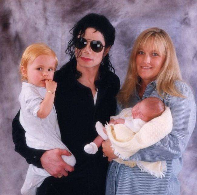 Paris Jackson with her Mom and Dad Michael Jackson.