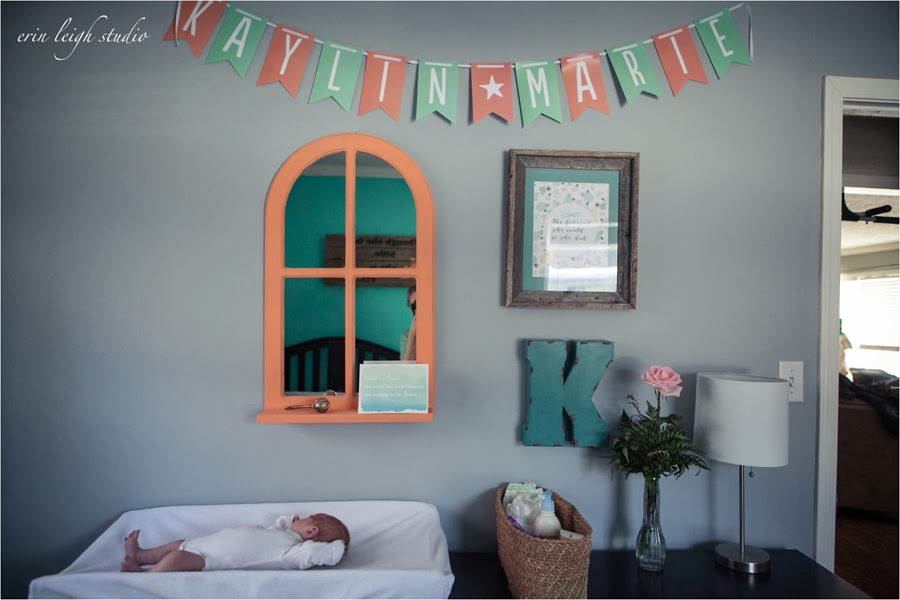 newborn photos in baby's nursery kansas city