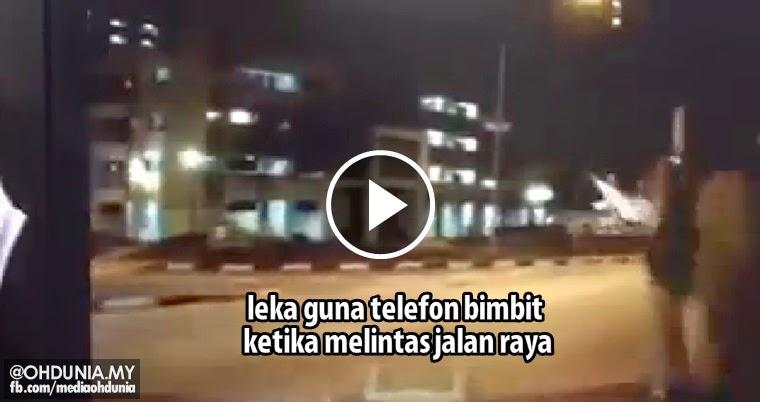 Video viral: Padah leka guna telefon bimbit ketika melintas jalan raya