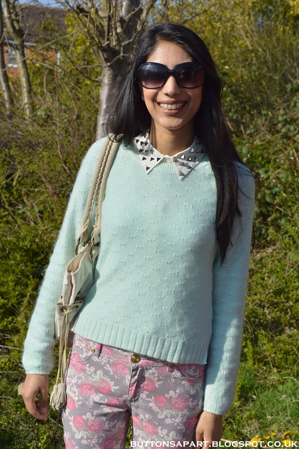 a picture of floral print jeans and mint green jumper