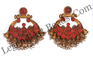 VISIRIMURUGU Fan shaped earrings south India 19th century fan shaped earrings in gold set with rubies like these were worn in the scapha of the ear.