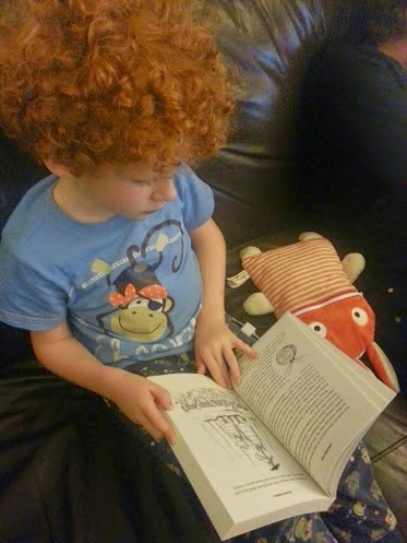 6 year old boy reading Arvor's Schooldays book