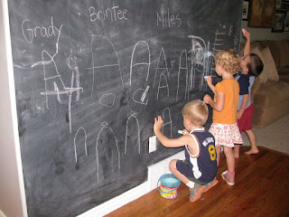 kids writing on chalkboard