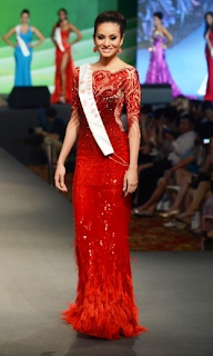 Queenierich Rehman in a stunning Michael Cinco creation. The red gown was worn during the World Designer Event of Miss World 2012