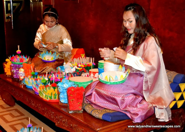 Thai ladies making colorful paper flowers