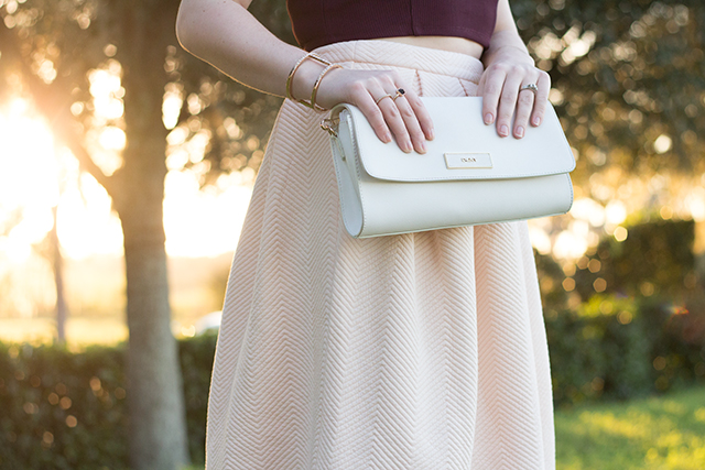 White DKNY saffiano leather fold-over clutch.