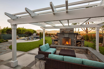 modern outdoor patio design with beautiful furniture and gorgeous fireplace