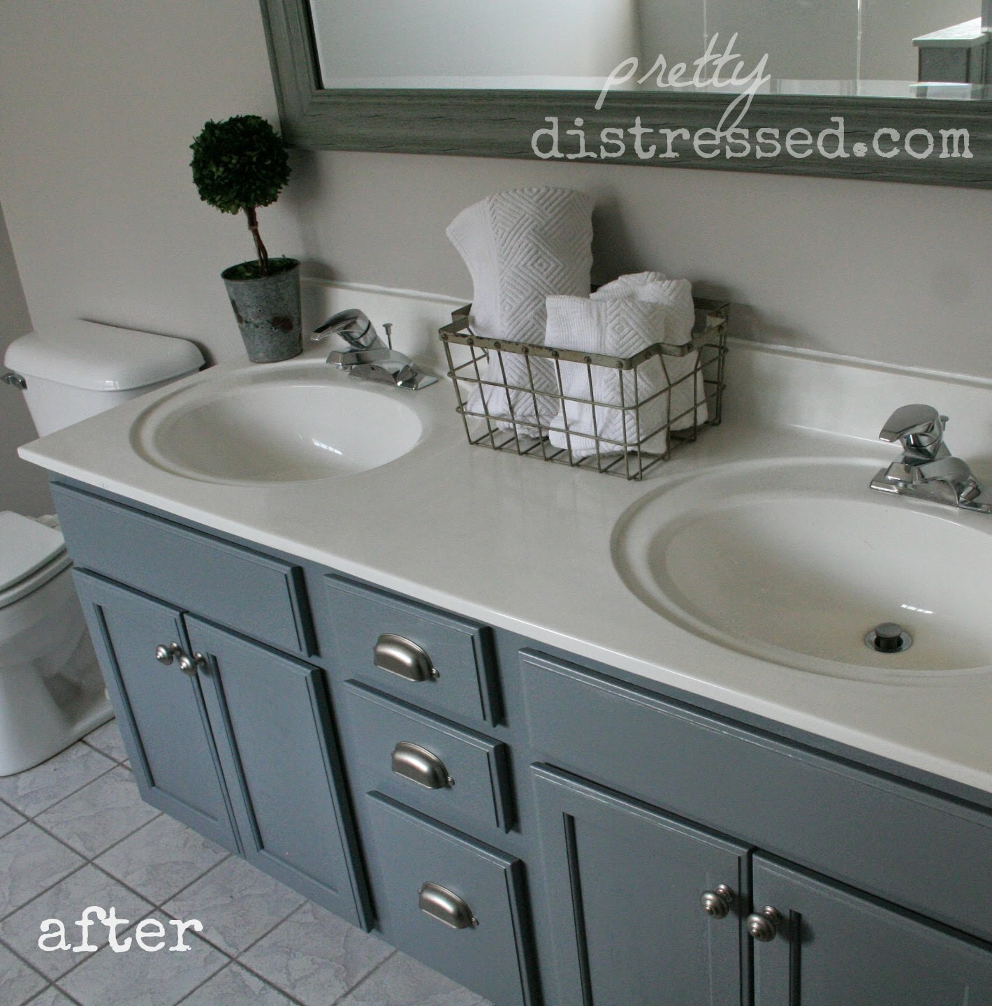Painting And Distressing Bathroom Cabinets pretty distressed: bathroom vanity makeover with latex paint