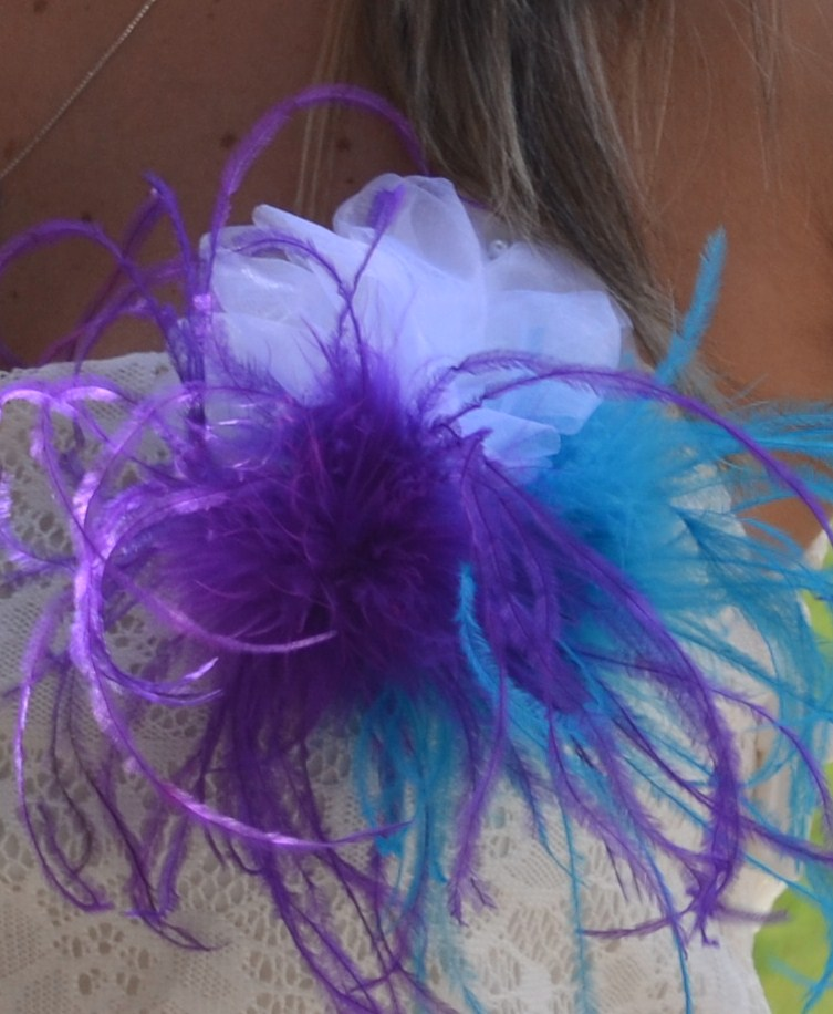 one of the items i put together for tessas shower was a could not be easier but so frilly fun corsage i love the playfulness of the feathers it