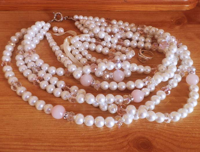 Pearl necklace, bracelet, and earrings and a silver ring