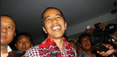 presiden jokowi menggunakan baju dari kain sasirangan