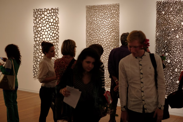 Artworks and crowd, Lindy Lee, One Billion Worlds - Roslyn Oxley9 Gallery 2012