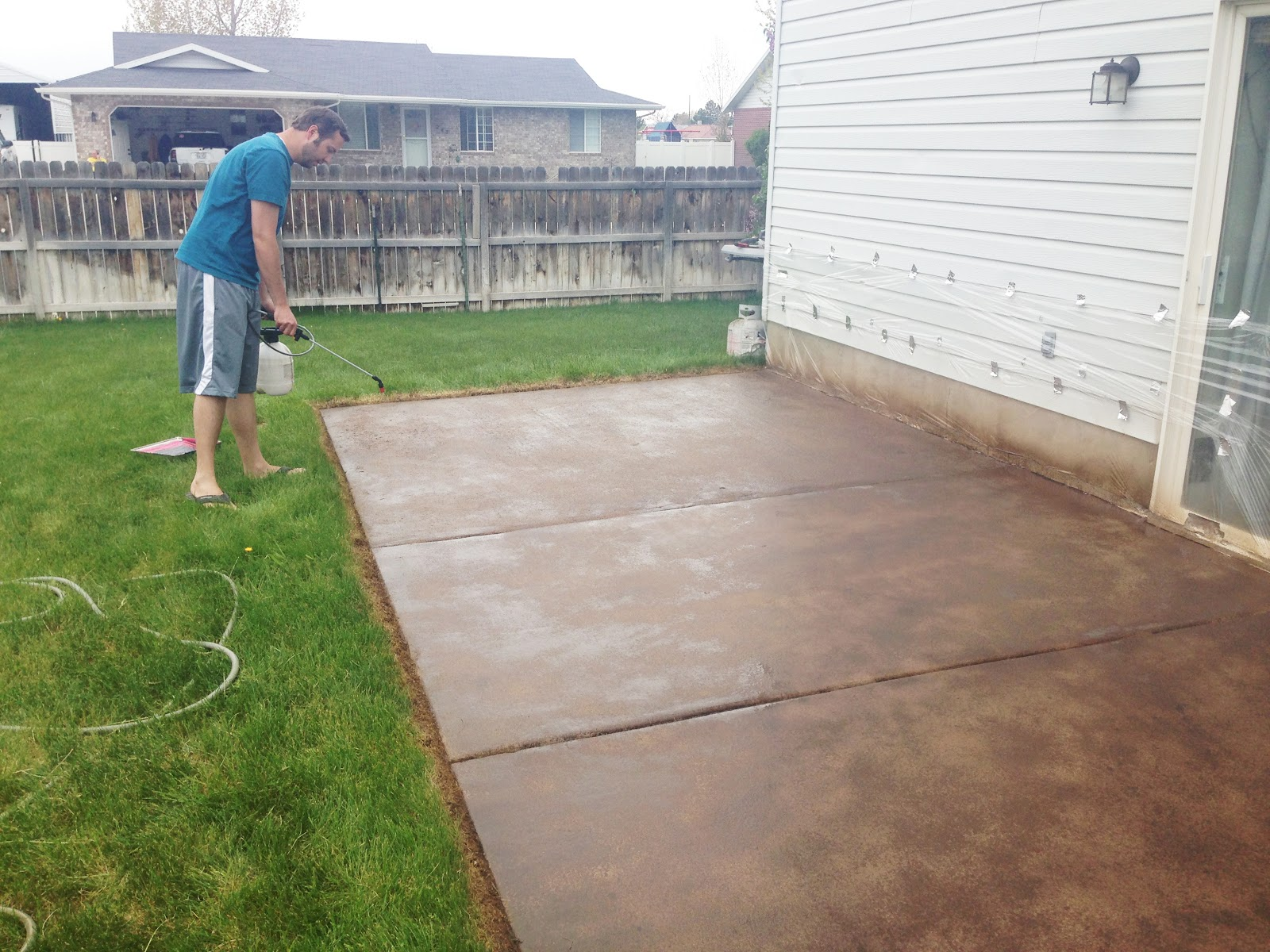 How to stain a concrete patio chris loves julia for How to clean outdoor stained concrete