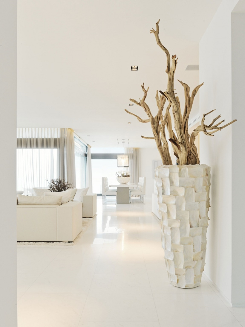 White furniture and floors in Modern Mansion Built On The Cliffs