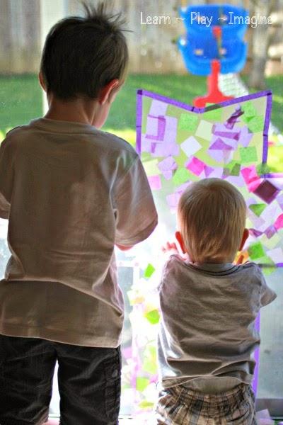 Simple cross suncatcher art project for kids