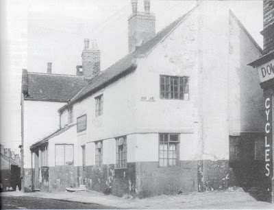 A black and white picture of a delapidated pub