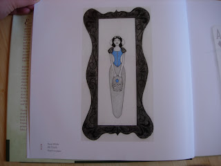 Snow White with eyes closed standing or lying down. A drawn frame surrounds her.