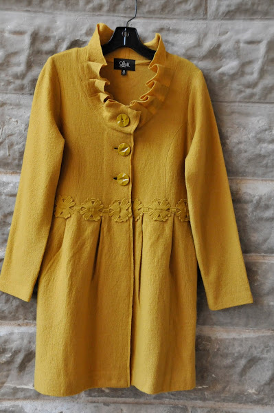 Mustard boiled wool coat with floral appliques at waist, ruffles and buttons.  S-XL $128
