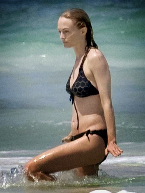 Looking every inch to the 44-year-old as Heather Graham strolls around by herself along the beautiful wave in a mix-match black bikini and can't hide her cheerfulness for the Mexican wave on Thursday, June 19, 2014, Graham nails off-duty cool like there's no tomorrow.