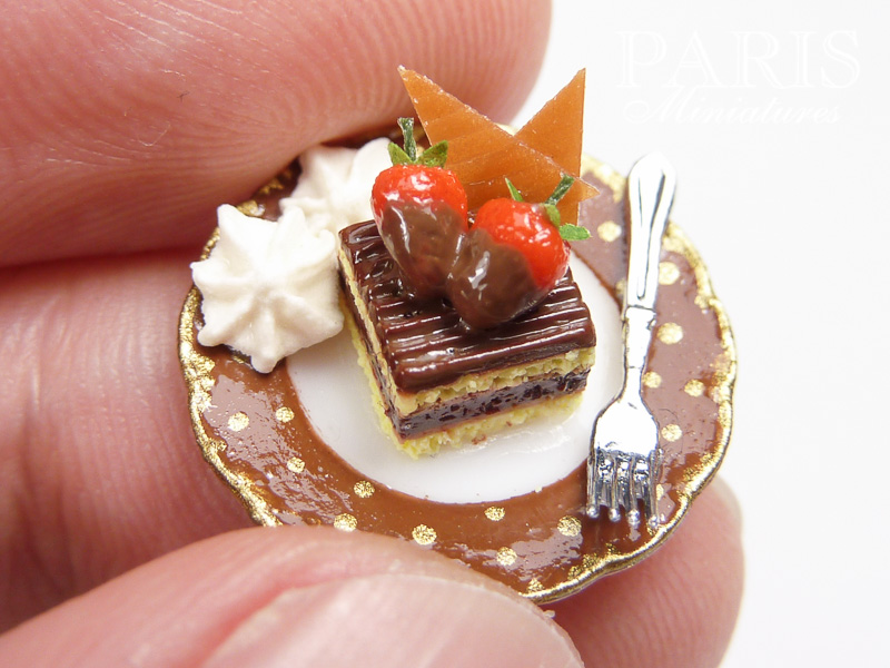Chocolate dessert plate decorated with chocolate-dipped strawberries and caramel and served with cream