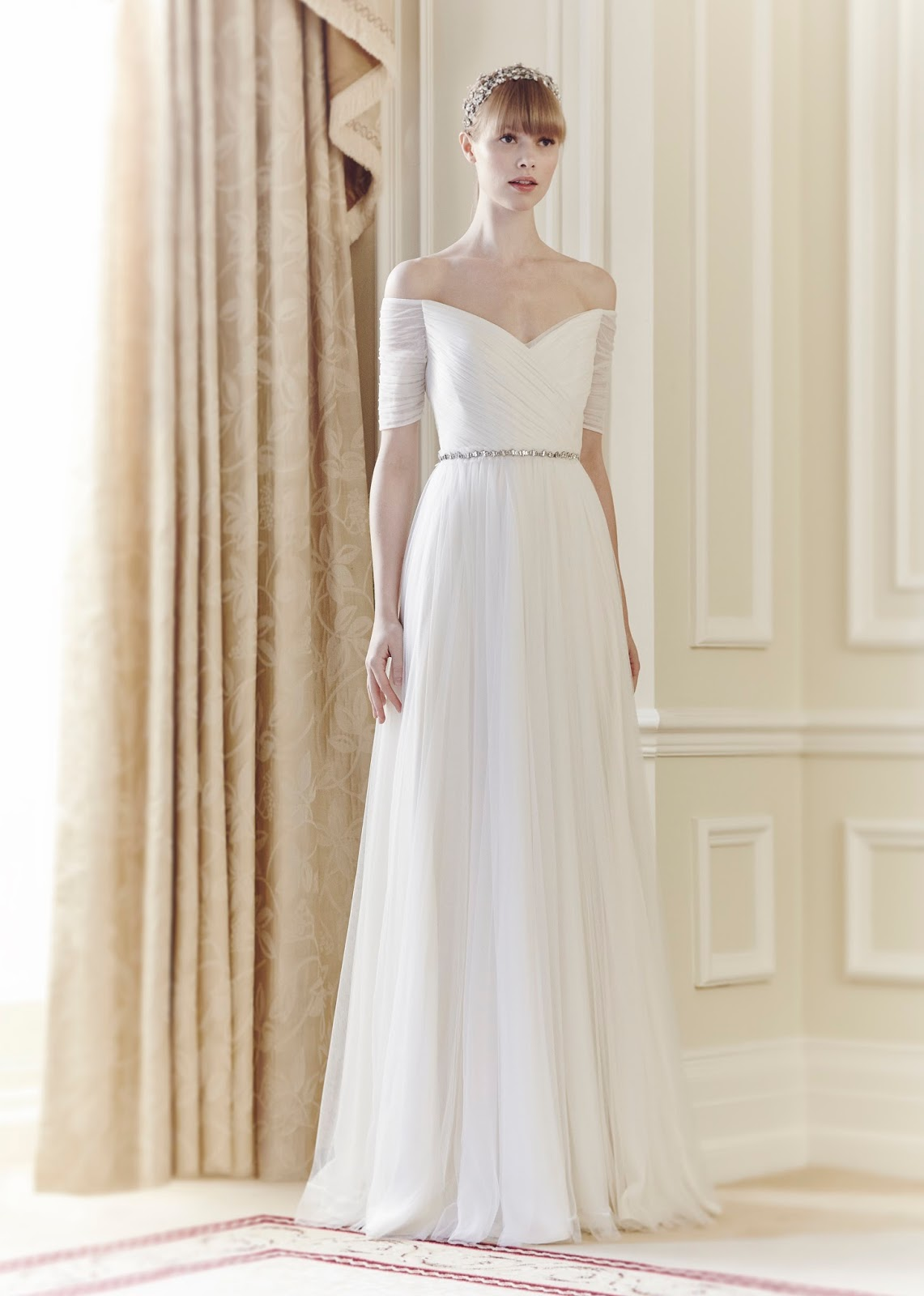 http://www.aislestyle.co.uk/off-the-shoulder-half-sleeeved-aline-tulle-wedding-dress-p-158.html