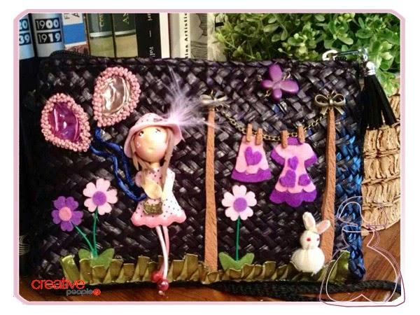 Bolso de rafia decorado a mano por Sylvia Lopez Morant